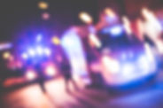 blurred-emergency-cars-at-night-picjumbo