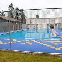 blue and yellow tiled outdoor pool