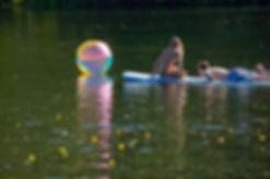 Teens on Paddle Boards on Cain Lake