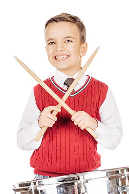 Portrait Boy young boy drumming on white