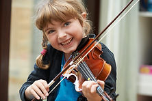 Portrait Of Young Girl Learning To Play