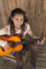 young girl playing the guitare.jpg
