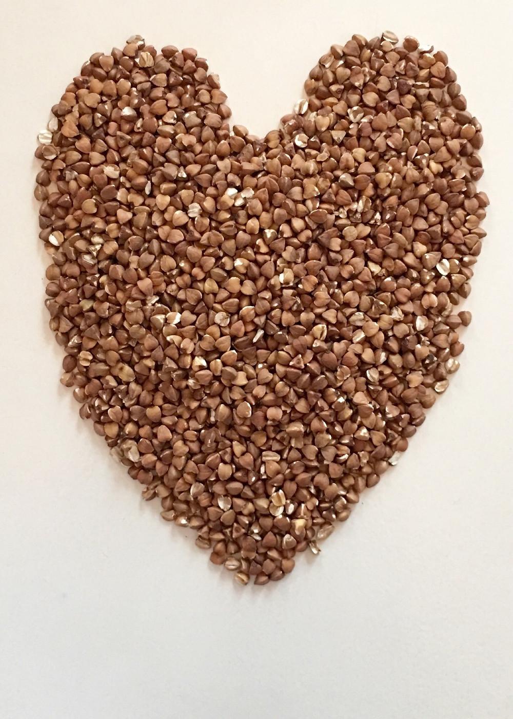 Buckwheat grains in a heart shape