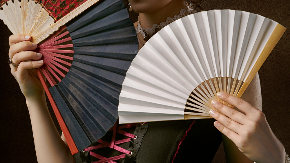 woman with fan at start of menopause
