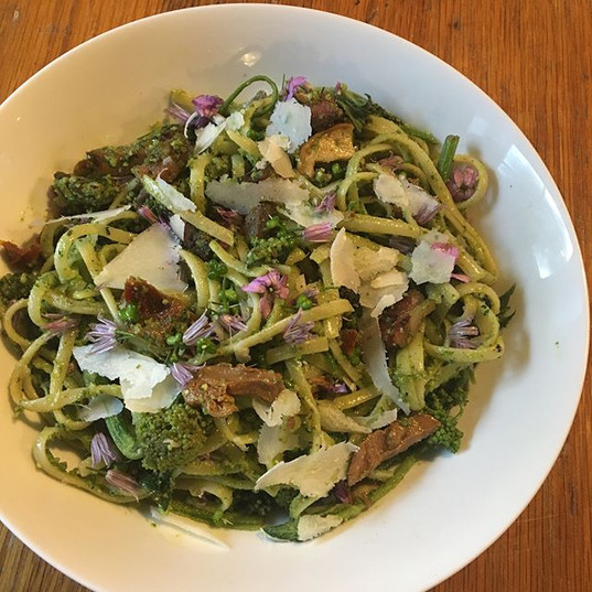 Big bowl of wild with mixed greens pesto (Wild Garlic, Orache, Sorrel and home grown Rocket), sautéed Hogweed shoots and flower buds, mixed_