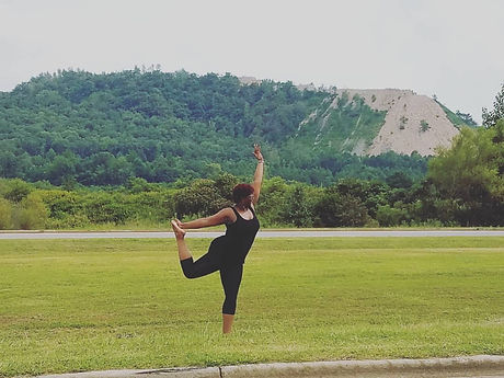 sher yoga in grass.jpeg