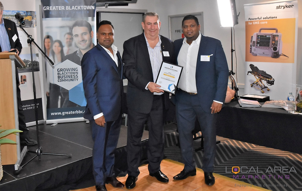 Castle Group directors Ritchie Perera (left) and Krenalin Moodley (right) receive their Gold Member certificate from Greater Blacktown Business Chamber President Trevor Oldfield.