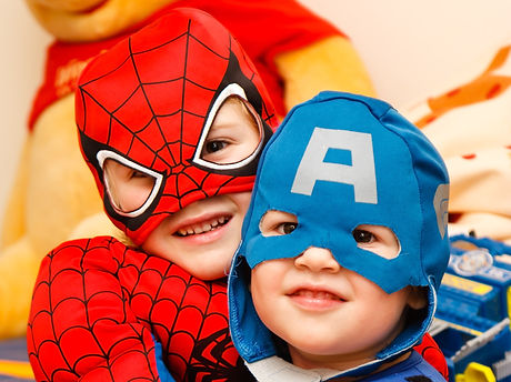Children in superhero costume
