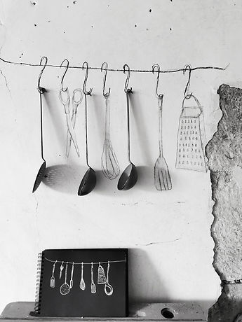 utensils hanging & sketchbook.jpg