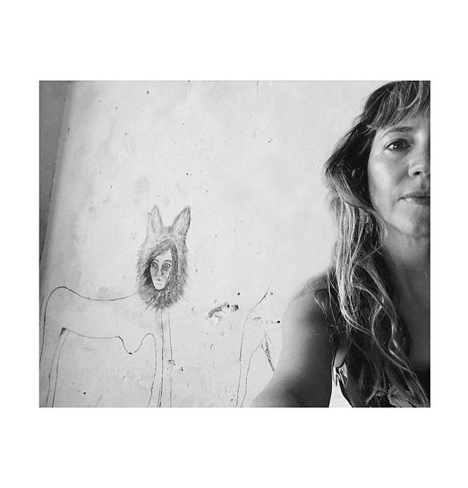 me 2 with drawings on wall white backgro