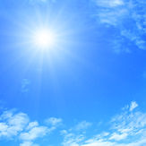Sun and blue sky with clouds..jpg