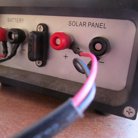 Wires run from the solar panels to the charge controller