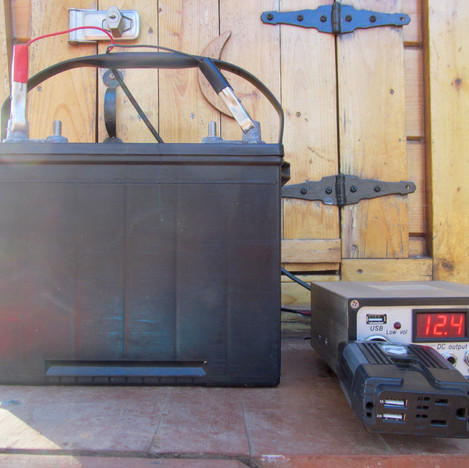 Marine battery, charge controller, and inverter (plugged into the charge controller)