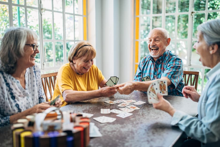 Seniors playing card game