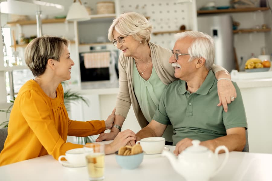 Couple Discussing Retirement Communities With Daughter