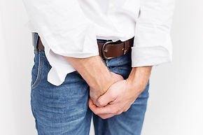 Man covering his crotch with his hands