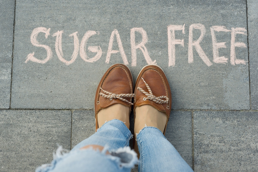 Sugar free label in front of woman's shoes