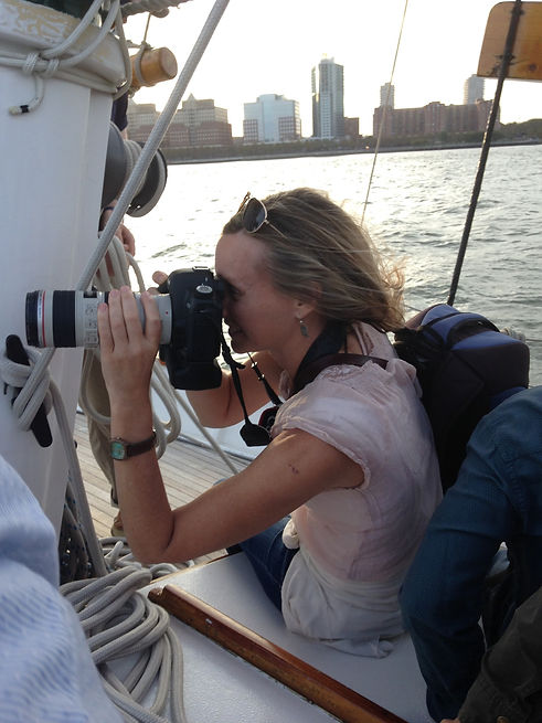 Ellen with camera on boat