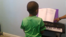 A young piano student performing in a virtual recital hosted by Quaranteen Music Lessons
