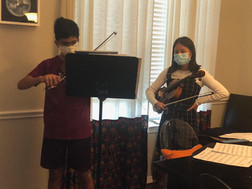 A student from Texas receiving a viola lesson from high school junior Kendall Nguyen