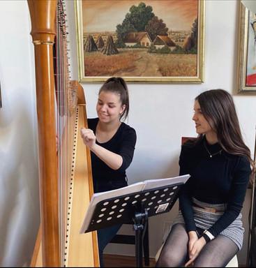 Harp tutor Iva Dimitrijević teaching a private lesson to her student in Novi Sad, Serbia