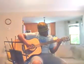 A guitar student from Maryland receiving volunteer lessons online