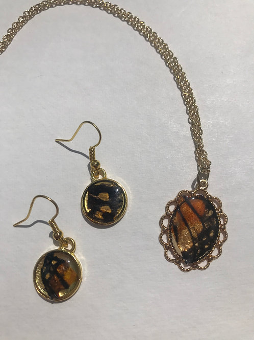 Gold toned butterfly necklace and matching earrings