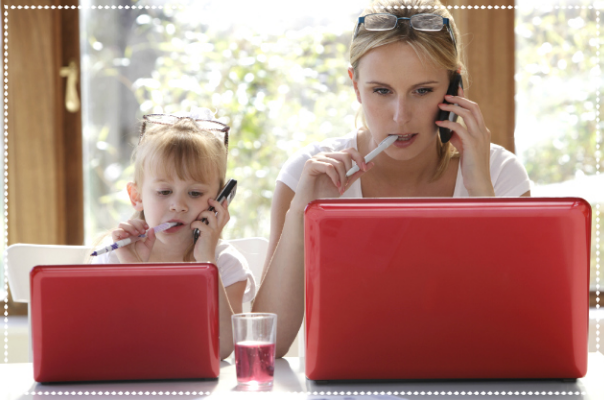 Working mum and daughter during Summer holidays