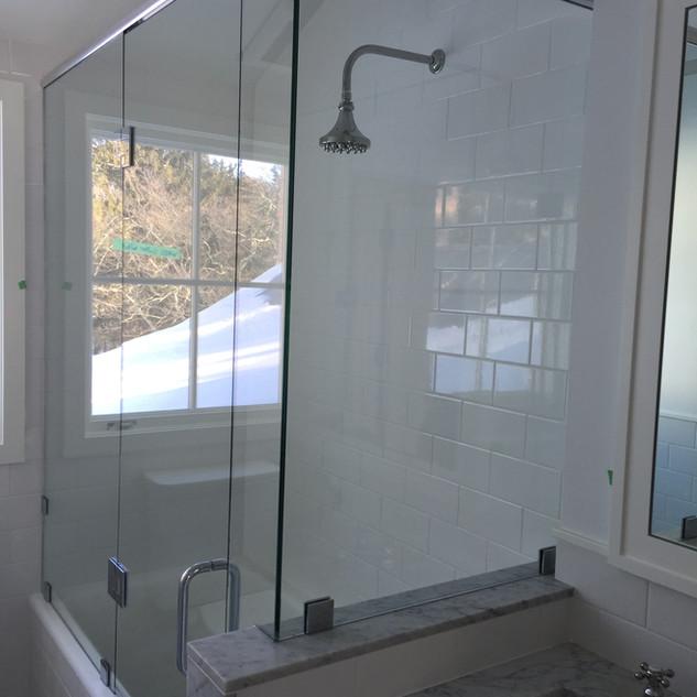 Frameless tub enclosure with header and 90 deg return.jpg