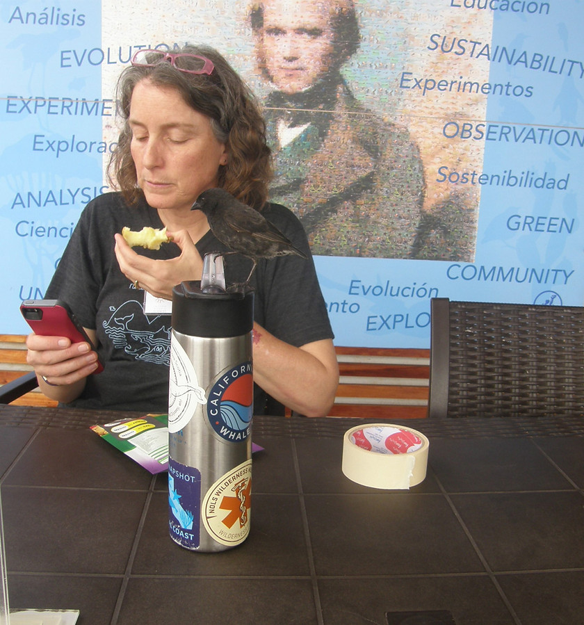 Moe Flannery, Charles Darwin looking over her shoulder, and one of his finches (on the thermos)  during a snack break.