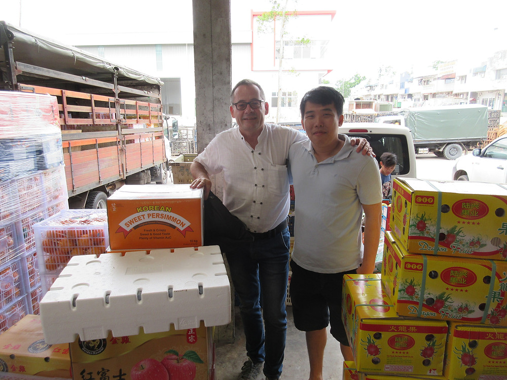 Oliver Huesmann and chinese Fruit Importer
