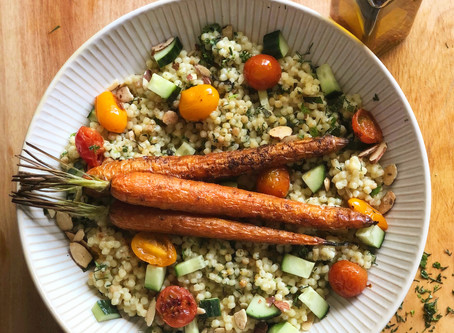.Lemon and Garlic Couscous Herb Salad with Blistered Tomatoes and Cumin Roasted Carrots.