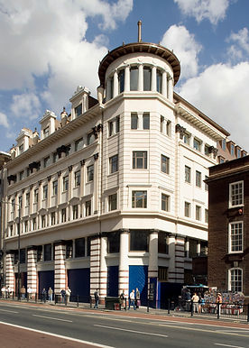 The overriding requirement for this project in the heart of London was for a landmark design that did justice to its premier location. The building adjoins a Wren church on one side and the old Simpson's building – a pioneering modernist structure from the 1930s – on the other. This mixed retail and commercial development contains over 6500m2 of office space and nearly 2800m2 of shops. The main impact of the eight-storey building lies in the Portland and Savonniers limestone facings coupled with cast bronze column capitals. Large granite-crested dormer windows and turned limestone urns 3m high create a dramatic silhouette against a sloping roof.    The building used stone-faced precast concrete cladding panels from The Marble Mosaic Company in Weston-super-Mare. Indeed, through main contractor Sir Robert McAlpine, the company was responsible for detail design, manufacture, delivery and installation of the panels in a contract worth in excess of £3m.    As well as the limestone facings, Chinese constellation grey and red Sanhe and Kashmir gold granite facings were used, along with three types of srock brick facings. The materials were assembled into cladding panels with reinforced concrete backings. In addition, some units were designed to act as structural elements supporting other cladding materials. Complete panels weighed up to 10 tonnes.