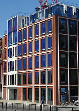 Precast cladding panels with York Handmade Bricks and Portland limestone facings.