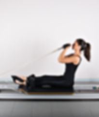 Bicep reformer position. Pilates gymnast