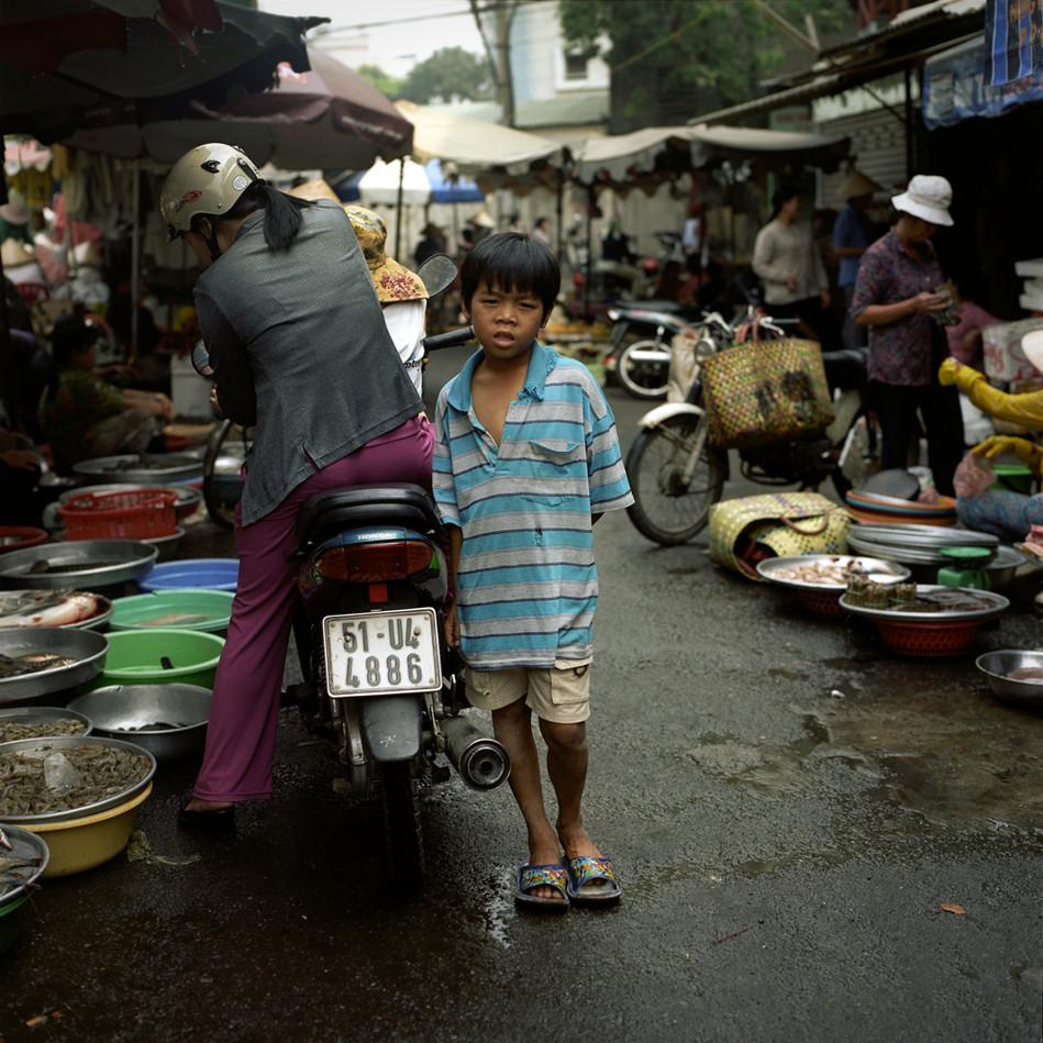 Boy standing in market