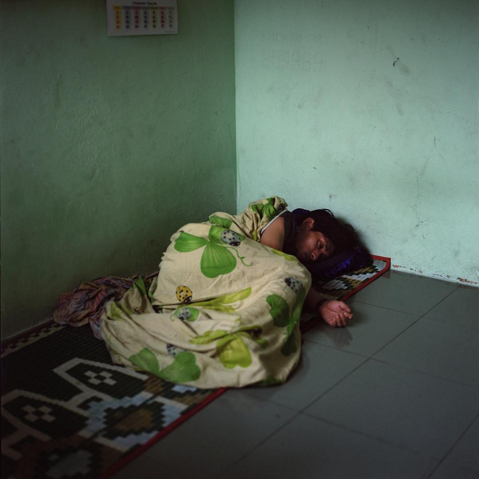 Woman sleeping under bug rug