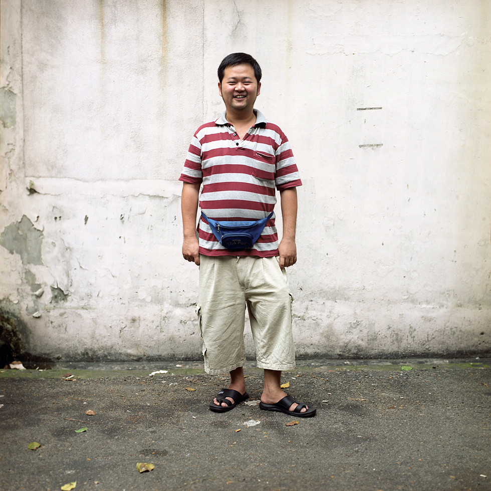 Man with bumbag and smile