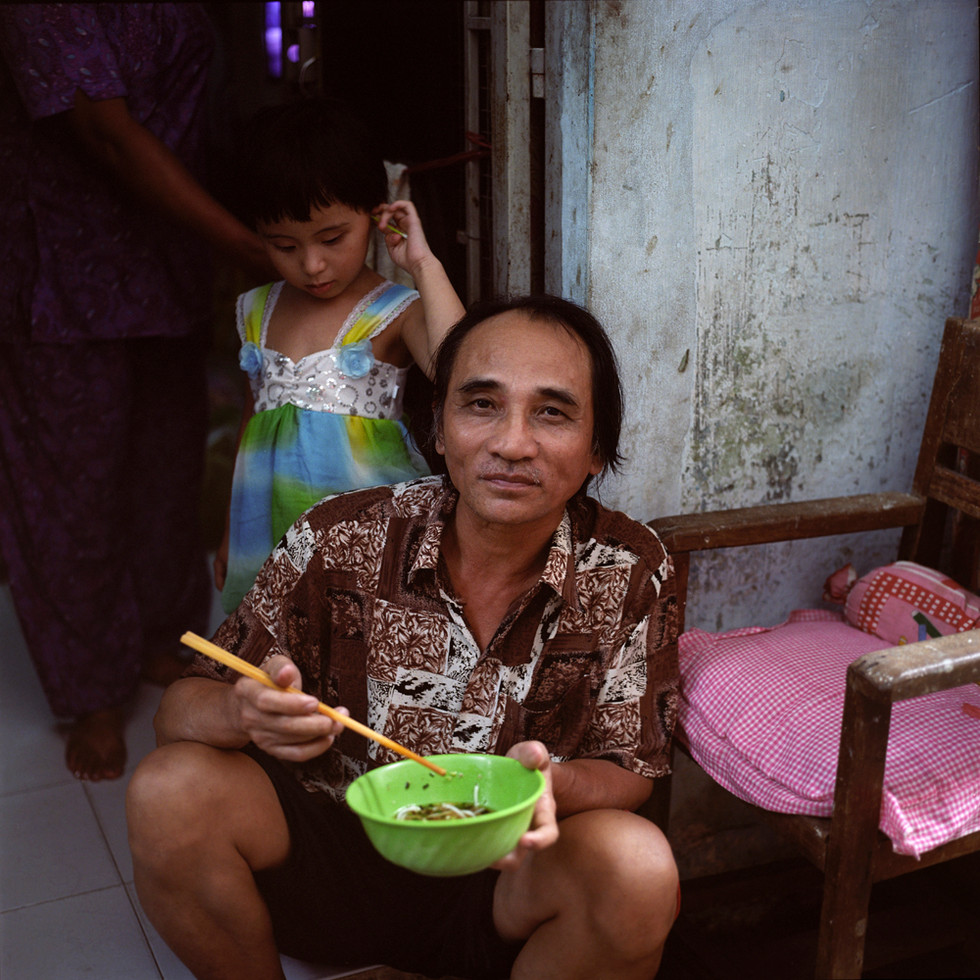 Man with bowl and daughter