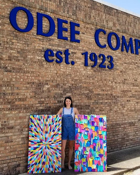Melissa picking up her custom print order from CanvasKick/The Odee Co.