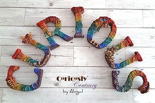 Rainbow Curious with Logo.jpg