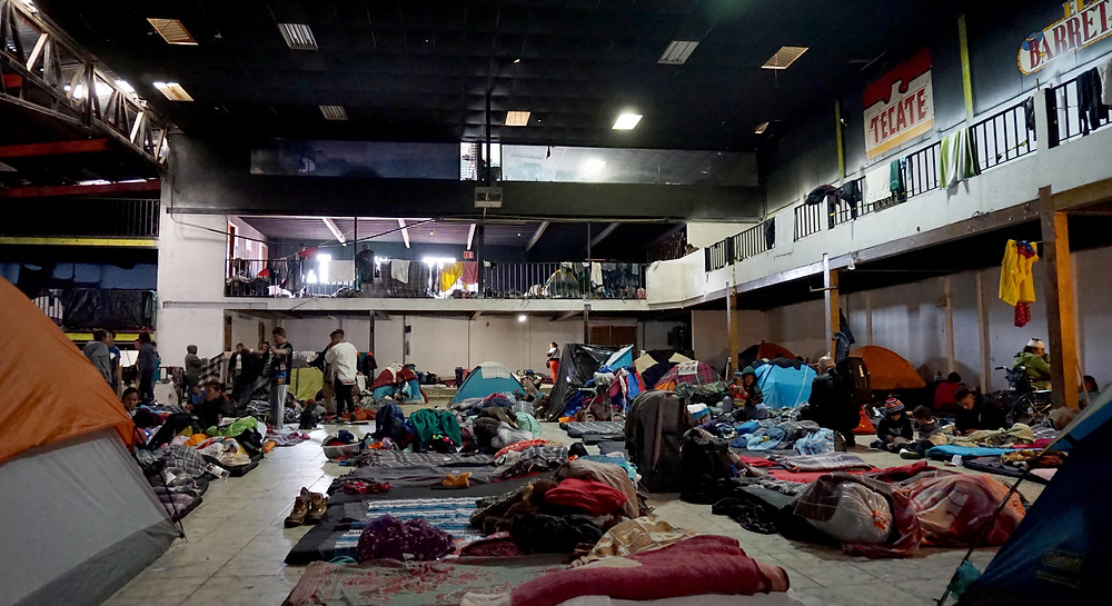 """People traveling in the so-called """"Migrant Caravan"""" were detained at the Barretal Refugee Camp that was located at the site of a former dance hall in Tijuana, Mexico. December, 2018. (Photo by Alexander Huang-Menders)"""