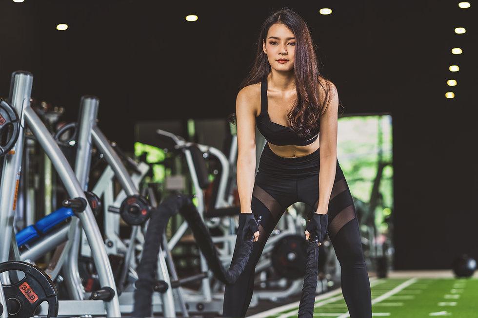 young-asian-woman-wearing-sportswear-doi