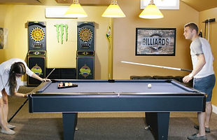 Image of Two People Playing Pool