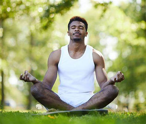 black man in grass yoga.jpg