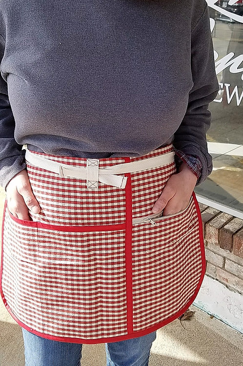 red gingham utility apron with zippered pocket