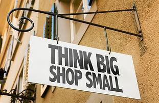 Think Big Shop Small sign in a conceptua