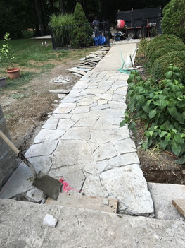 New Entry paved sidewalk - masonry