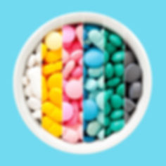 Colorful bright pills in a bow