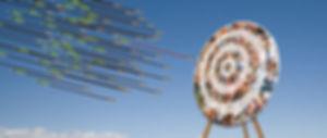 Arrows shootin towards a target audience bullseye